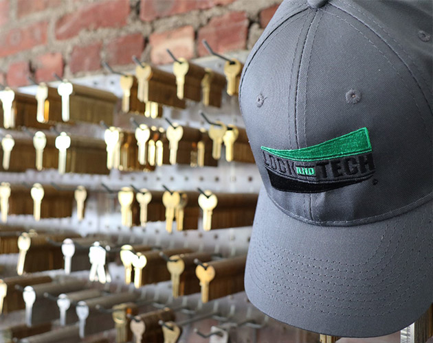 Lock and tech logo baseball hat