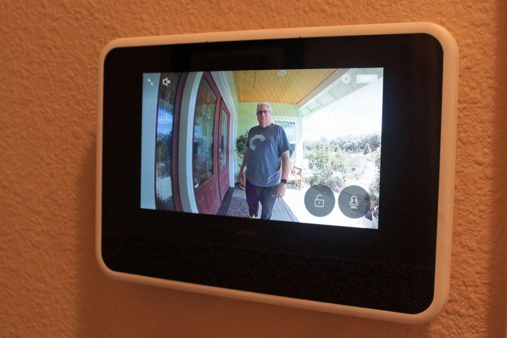 Man near front door pressed video doorbell